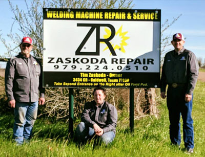 zaskoda repair sign with staff in front