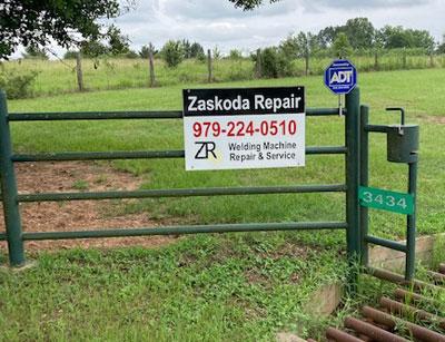 zaskoda repair sign at entrance gate